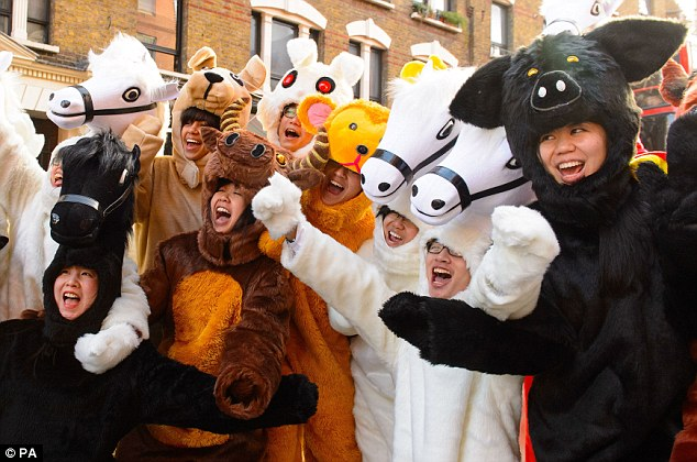 Horse costumes: Performers during the annual Chinese New Year parade through Central London yesterday