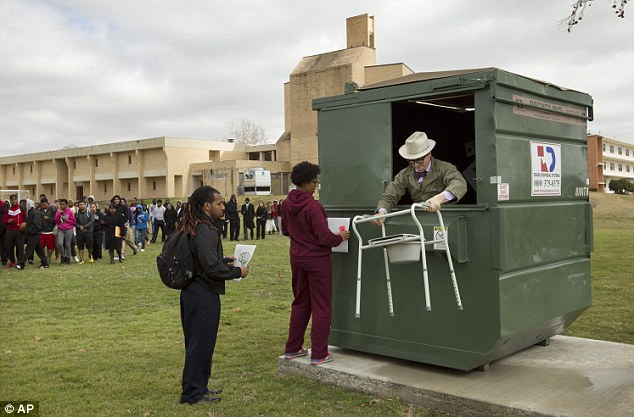 Dumpster time: Dr. Jeff Wilson, pictured Tuesday, Dean of the University College and Associate Professor of Biological Sciences at Huston-Tillotson University, moved into a 33-square foot dumpster on the campus of Huston-Tillotson University in Austin, Texas on Tuesday