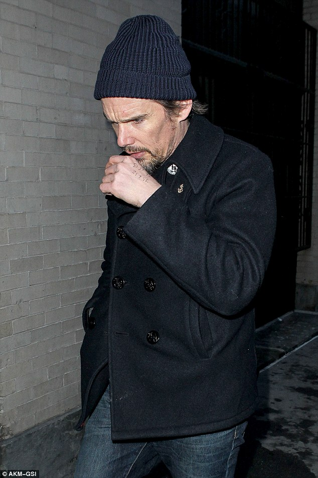 Visitation: Actor Ethan Hawke arrives on Tuesday evening at the house that his friend Philip Seymour Hoffman used to share with Mimi O'Donnell in New York City