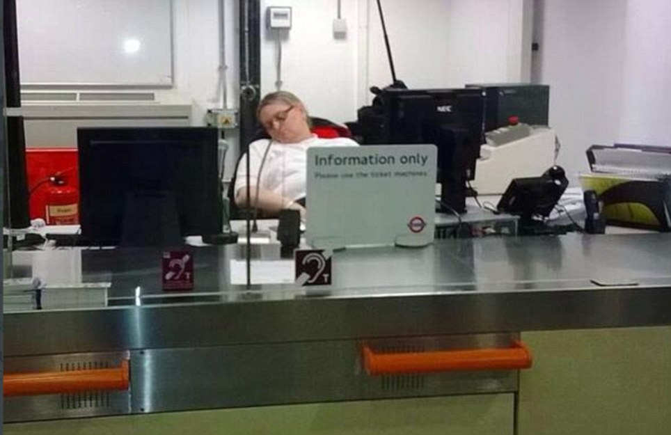 'Asleep on the job': A London Underground ticket office worker appears to be sleeping in her chair as she relaxes at Paddington station. Today Underground workers walked out on strike over proposals to axe 950 ticket office jobs