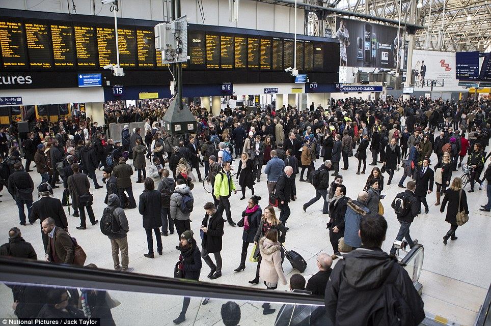 Busy: Waterloo train station at rush hour this morning. Many overground train lines were quieter than normal as commuters worked from home to avoid the disruption