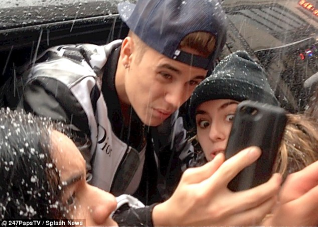 On the morning after the jet was searched, Justin Bieber was spotted out in NYC posing for pictures with his adoring fans in the snow