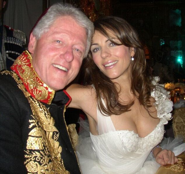 Having a ball: The alleged tryst that was revealed today is said to have happened in 1998 but Clinton and Hurley were pictured together in 2005 at a Russian charity masquerade ball