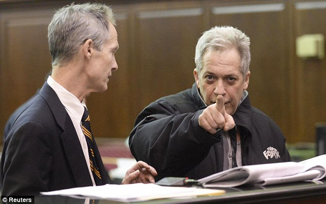 Hey you: Vineberg, a jazz musician, points at a camera as defense attorney Edward Kratt looks on during his arraignment in court