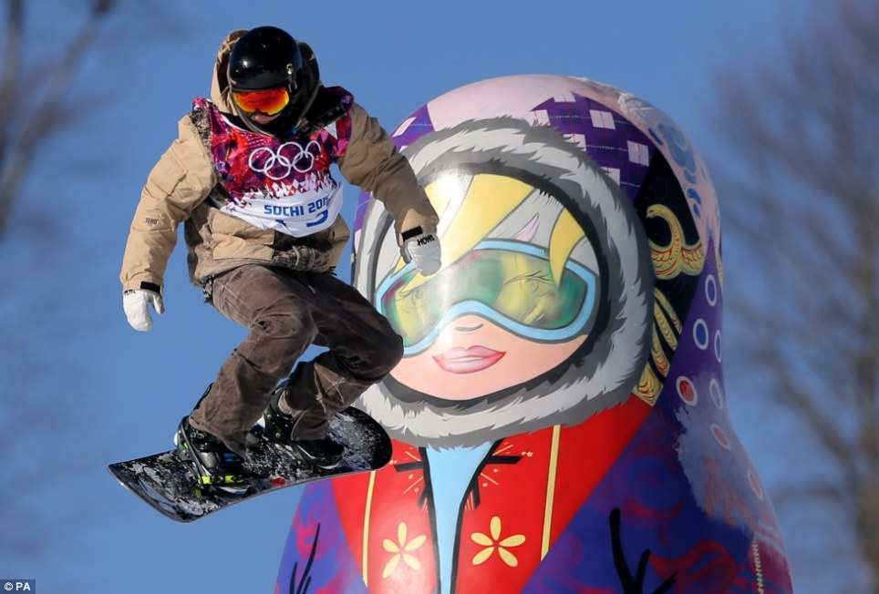 What a dolly day! A competitor makes a jump in front of a matryoshka doll during snowboard Slopestyle training at the Rosa Khutor Extreme Park