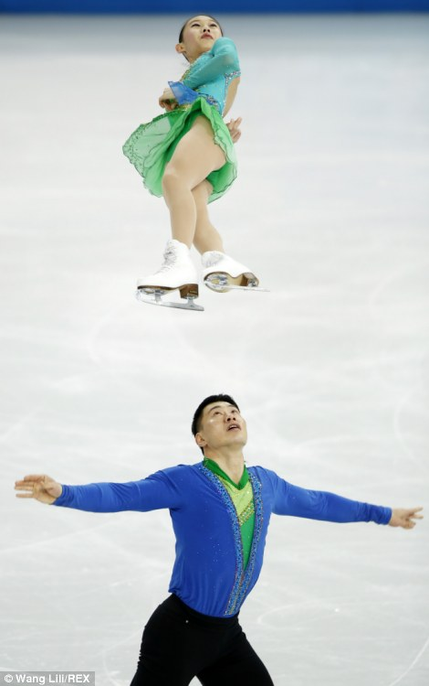 Zhang Hao (bottom) and Peng Cheng of China compete during the Team Short Program Pairs of Figure Skating