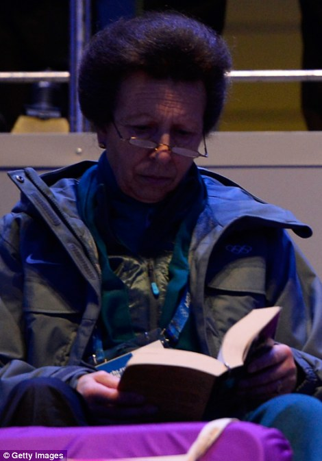 One is not particularly amused: The Princess Royal, Princess Anne, did not seem to find the spectacle at the Fisht Olympic Stadium interesting enough, so went into her bag to grab a good book instead