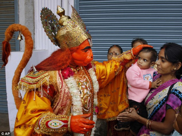 Monkey man: An Indian man dressed as a monkey god Hanuman, the Hindu deity the villagers believe Mr Oraon represents (stock image)
