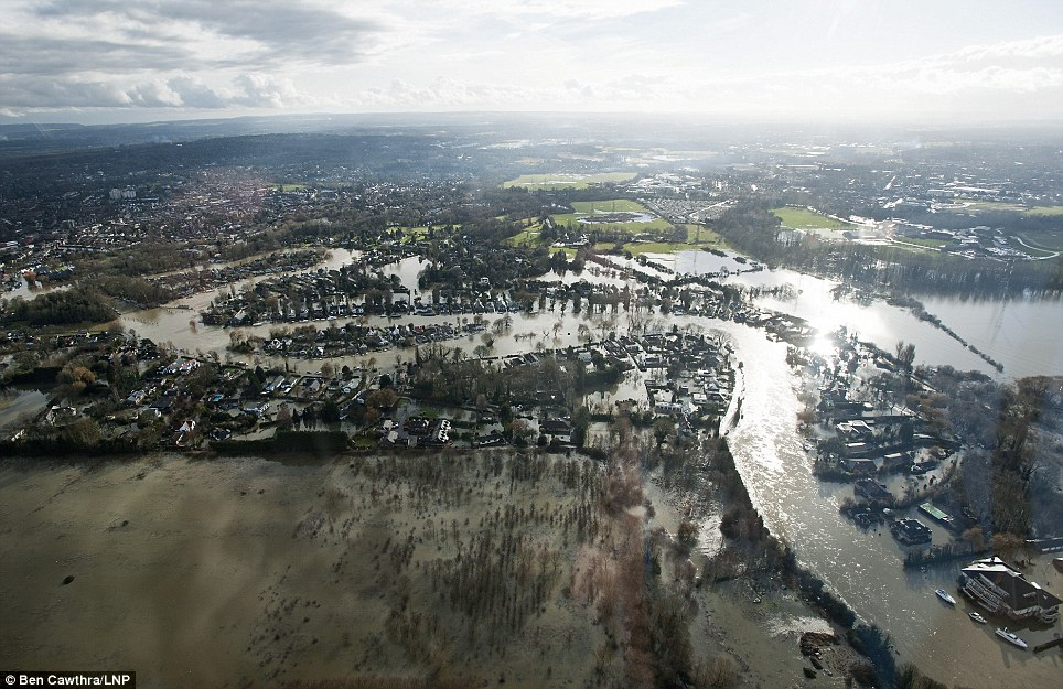 From above: Aerial view showing flooding covering Shepperton, Surrey. The Thames has hit record levels causing extensive flooding to parts of the South-East