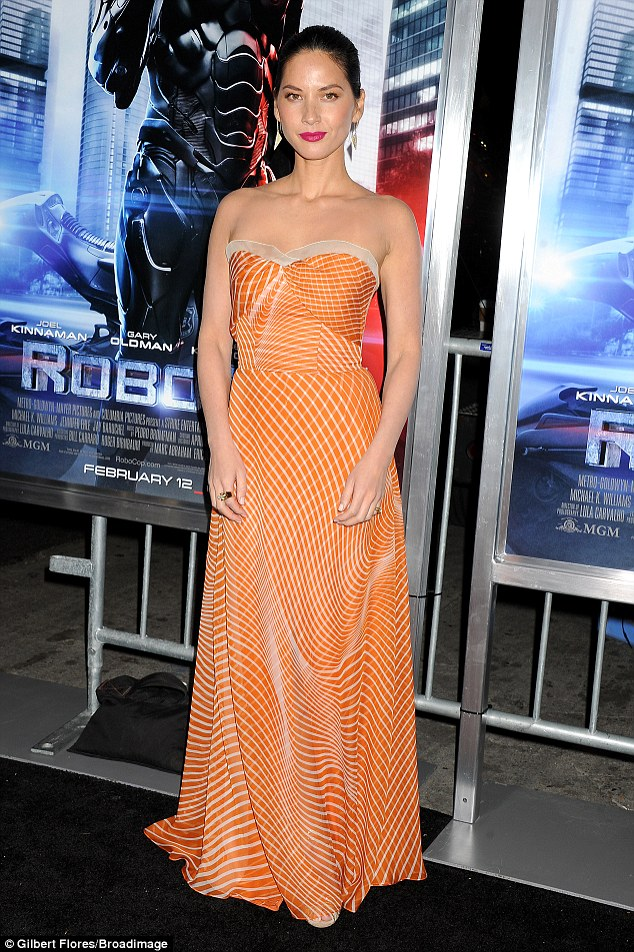 Summer style: Olivia Munn looked stunning in the orange strapless gown she wore to the RoboCop premiere in Los Angeles on Monday night