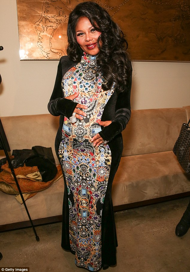It really IS a Big Momma Thang! Lil' Kim poses backstage at the The Blonds fashion show during MADE Fashion Week Fall 2014 in New York City