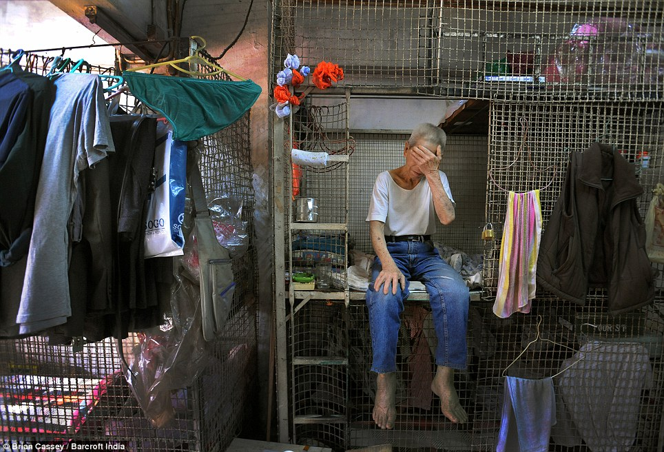 Retired manual labourer, 79-year-old Tai Lun Po, has lived in his cage home for 30 years. The inhabitants are stacked on top of each other in damp, dark conditions