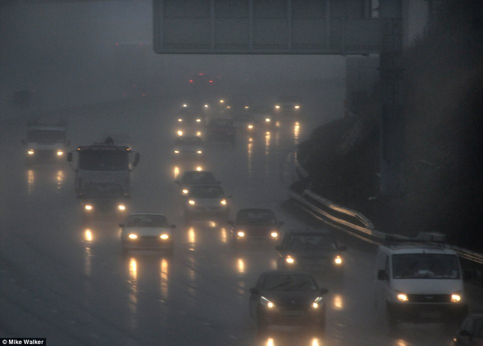Darkness at noon: The M27 passing Portsmouth was clothed in a near-black fog today