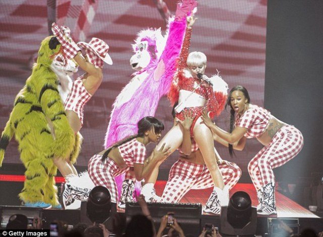 Wild night: The Bangerz backup dancers got quite hands on with Miley