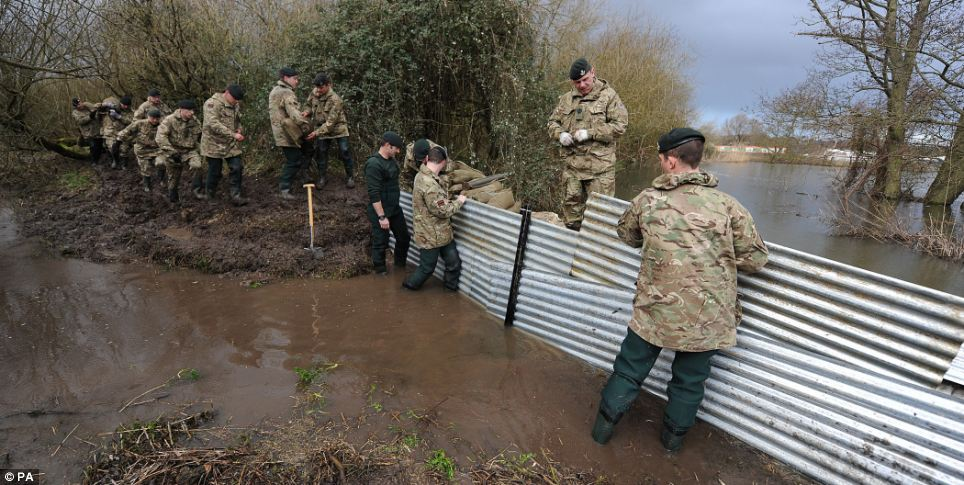 The Army has been drafted in to help build flood defences in Burghfield, Berkshire in a bid to ward off yet more flooding
