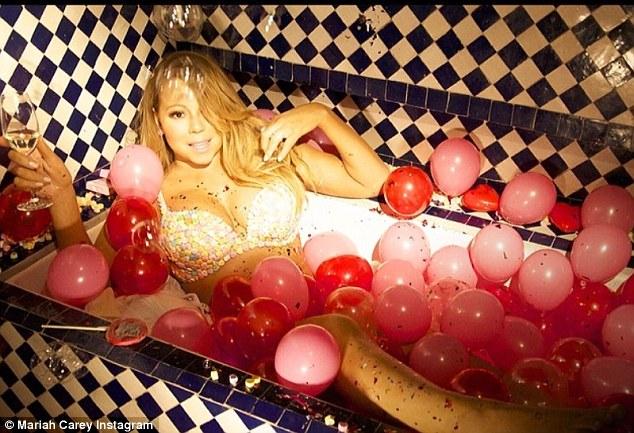 Mariah Carey Takes The Plunge In Elegant Scarlet Gown As