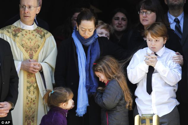 Mourning: Hoffman left most of his fortune to his long-term partner Mimi O'Donnell, pictured center at his funeral. They had three children together - Willa, left, Tallulah, center, and Cooper, right
