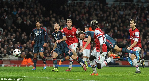 Unmarked: Muller stoops to bundle his header down into the turf and then into Arsenal's net