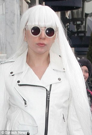 lady gaga tries to hide her natural hair under a hat daily mail online