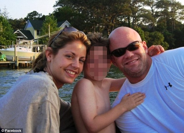 Family: This is Mark Kennedy and his wife Julia with their son - at home in Baton Rouge, Louisiana