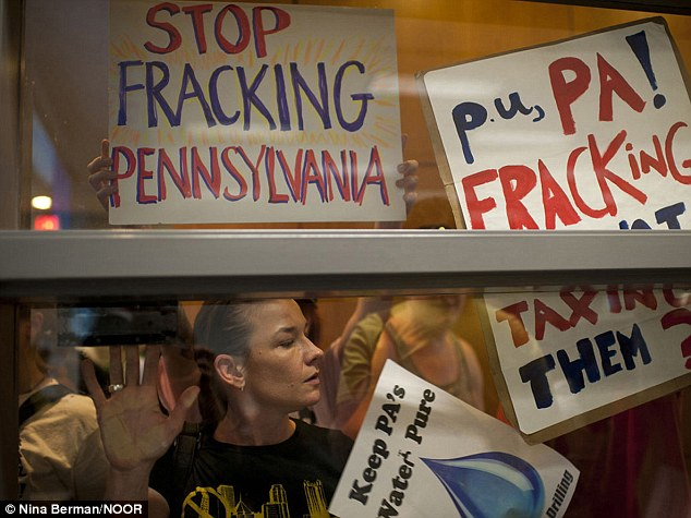 Dana Dolney, a breast cancer survivor, protests against gas drilling and the technique of hydraulic fracturing (fracking) outside Pennsylvania's Department of Enviornmental Protection (DEP) office where the Marcellus Shale Advisory Commission was holding a meeting.