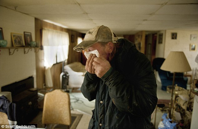 """After workers hauled away two water tanks that had supplied three homes from his backyard, John """"Denny"""" Fair went inside his small home and became teary-eyed. When Fair re-connected his water well, for which the tanks had provided an alternate supply, it pumped out orange-brown water that he and the neighbors don't want to use. Fair said the water turned brown and """"stinky