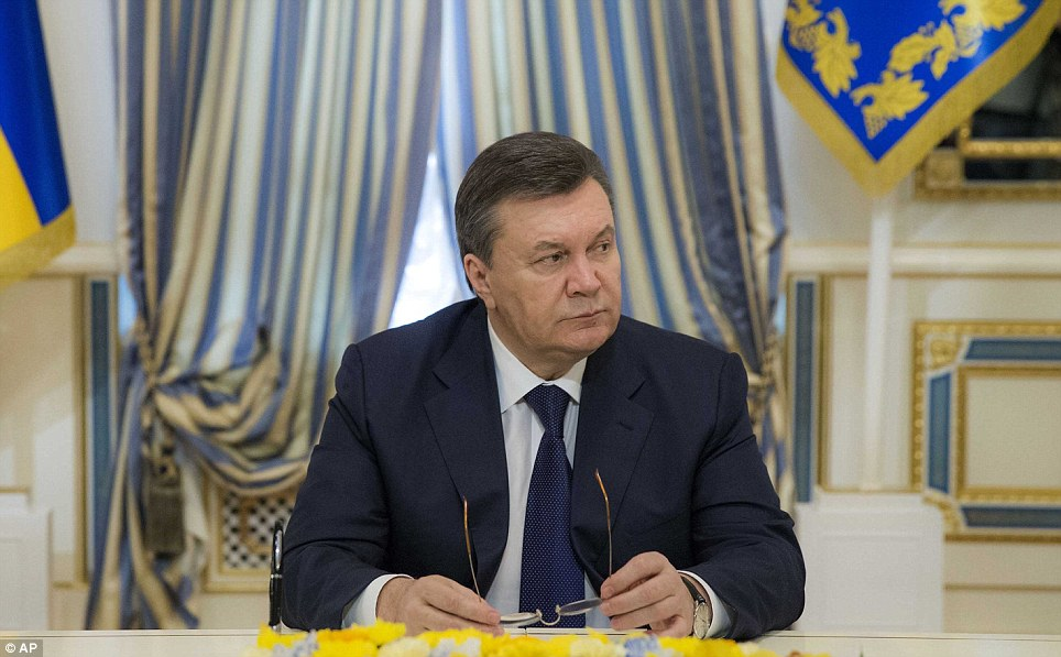 The ousted President looked defeated as he waited to sign the agreement aiming to end the violence which has engulfed the Ukrainian capital