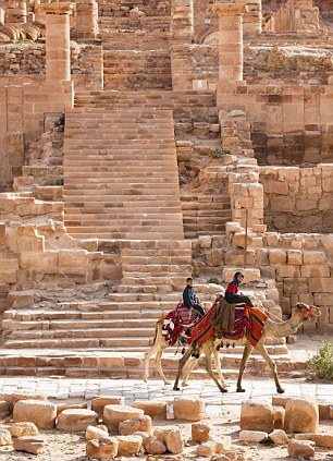Ships of the desert: Youngboys riding camels in ancient Petra