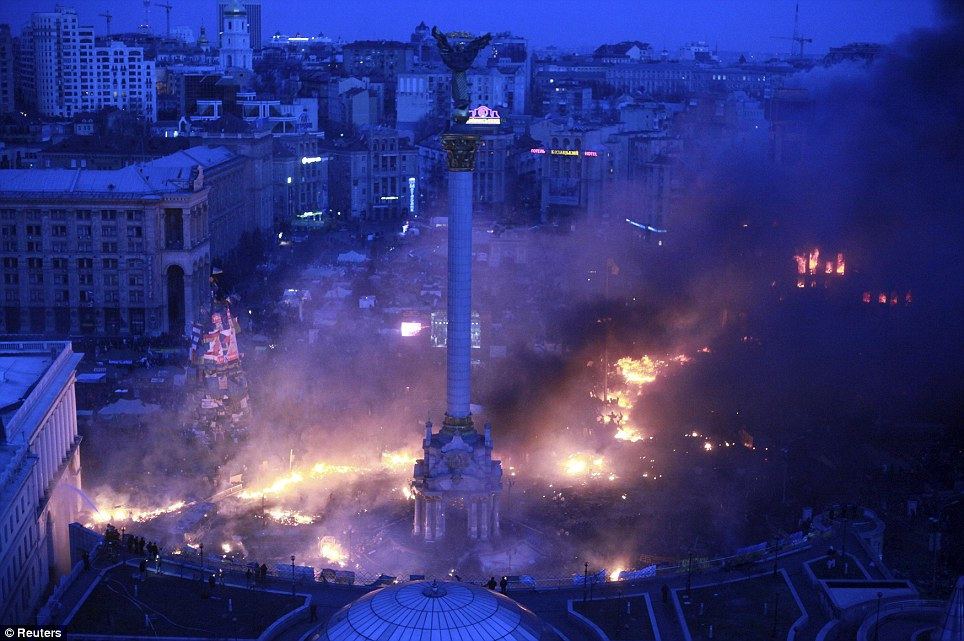 Smoke rises above Independence Square during anti-government protests in central Kiev in the early hours of February 19