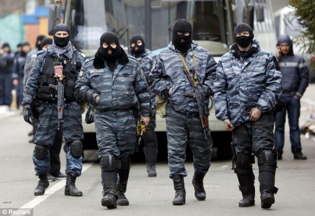 Begging for forgiveness: Members of Berkut anti-riot unit prepare to leave their barracks in Kiev