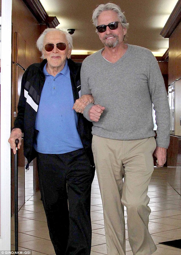Kirk Douglas 97 and son Michael 69 are in high spirits