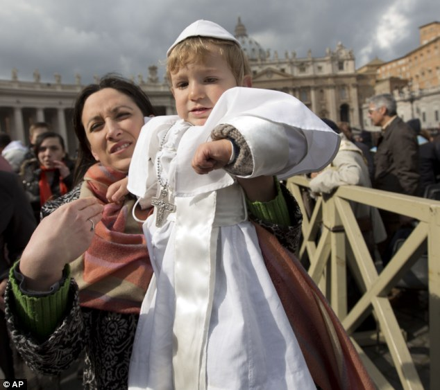 I want to see the pope: Paola Ciabattini, holding up her son Daniele, said she had dressed him as the pope in a demonstration of affection towards Pope Francis