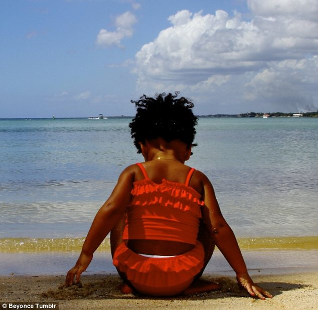 Little angel: Beyonce also shared an adorable picture of her daughter Blue Ivy on the beach looking at the ocean