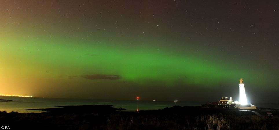 The skies were lit up red and green last night as a spectacular display of the Northern Lights illuminated parts of the country