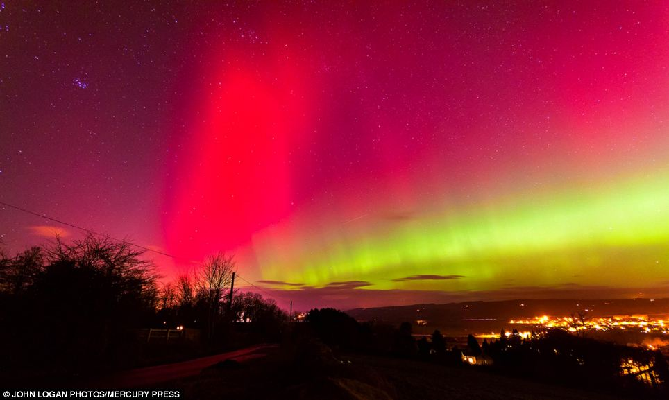 Bright: People across the UK revelled in a rare glimpse of the Northern Lights - stretching as far down as East Anglia. Above, the sky turns pink and yellow