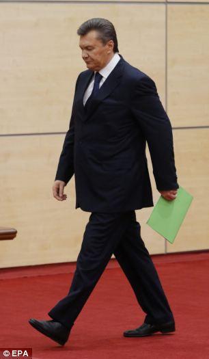 Former Ukrainian president Viktor Yanukovych arrives for a press conference