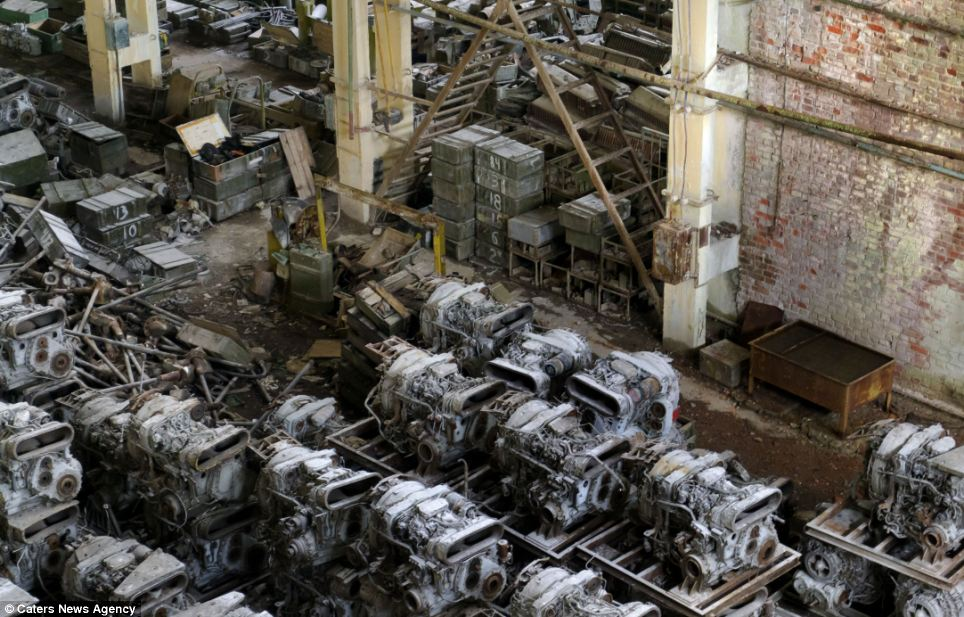 Abandoned: Despite the disused area being monitored by guards, Mr Itkin managed to sneak in and take several photographs of the neglected storage centre. Here dozens of old tank engines and other bits of machinery sit rotting on the factory floor