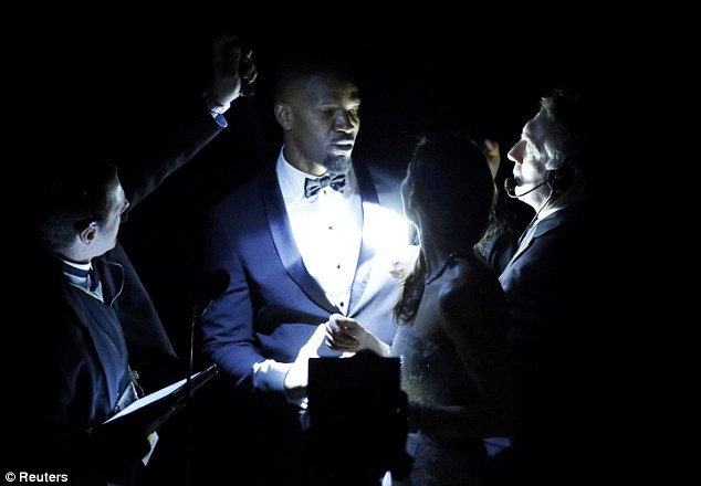 In the dark: Jamie Foxx stood backstage before presenting the Oscar for best original score