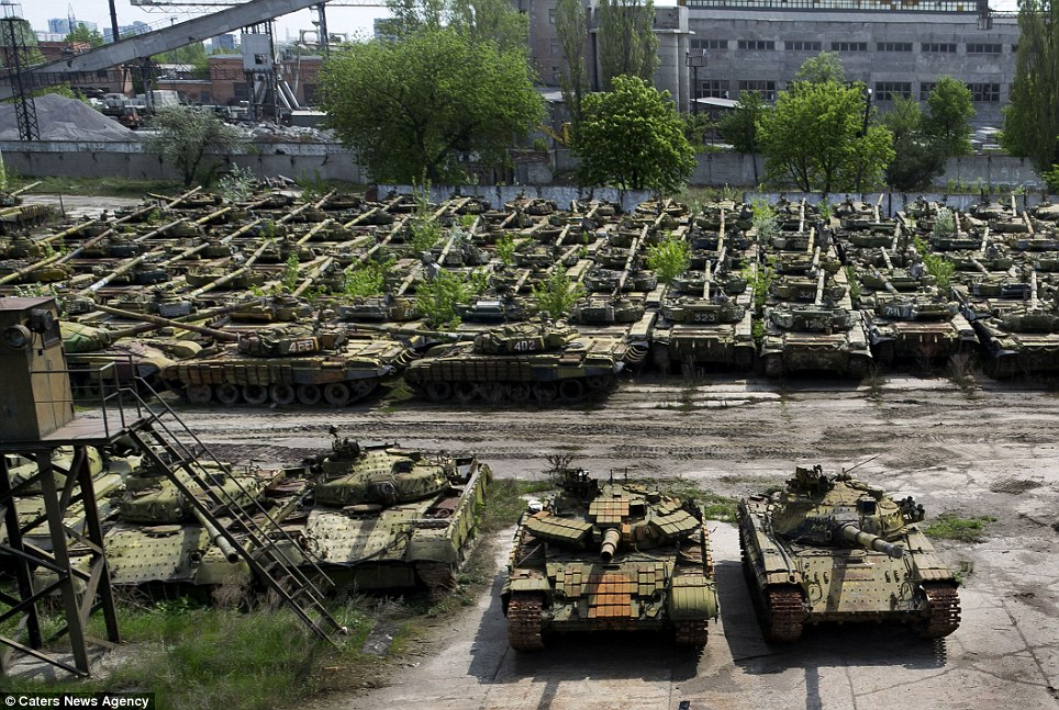 Forgotten: Filled with rows upon rows of slowly rusting relics, the once deadly war machines now lie dormant in a secret depot in the town of Kharkiv in the Slobozhanshchyna region of eastern Ukraine - just 20 miles from the border with Russia