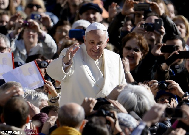 Loved: Pope Francis waves at the crowd upon his arrival at St.Peter's square for the weekly general audience on Wednesday