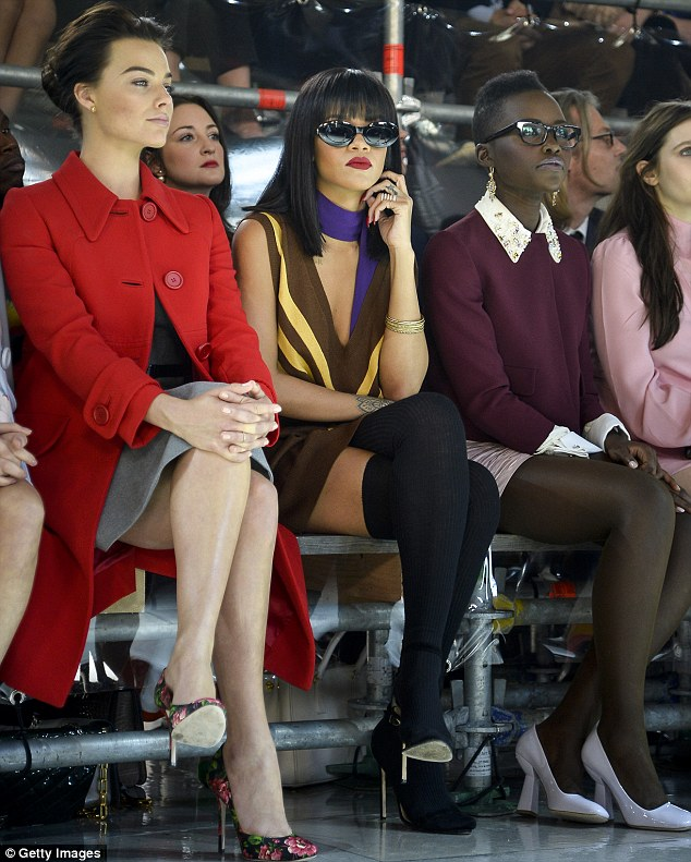 Specs appeal: Rihanna kept her sunglasses firmly on, while Lupita donned glasses to get a better look at the action