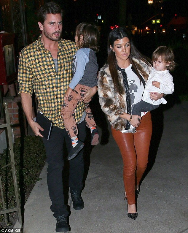 'Kourtney realised that she's all he has': The doting parents of Mason, four, and Penelope, 20 months - pictured in Calabasas on Tuesday - had reached an impasse where marriage was concerned, but the death of Scott's parents made Kourt 'see things differently'