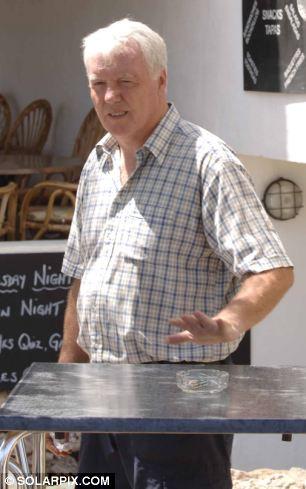 Retirement in the sun: Former detective John Davidson outside his bar in Menorca in 2006