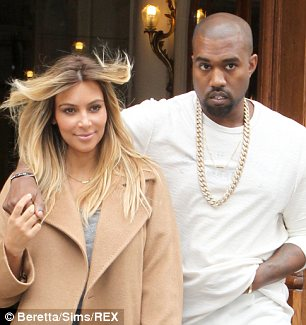 Final preparations: Kanye West and Kim Kardashian are finalising their pre-nup, which will see Kim get one million dollars for every year of marriage in the event of a divorce