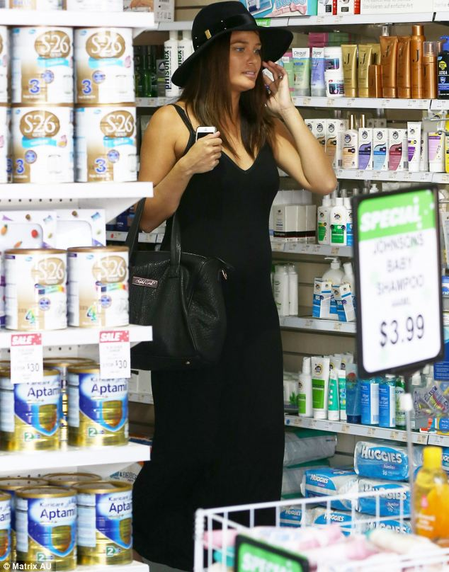 Looking great: Dressed in a black maxi dress with matching sun hat, the 29-year-old former Home And Away actress looked happy to be heading home