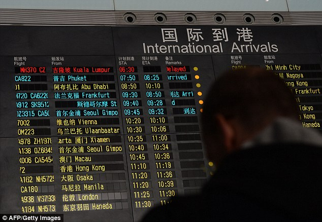 Concern: The arrivals board at Beijing Airport listed flight MH370 as being delayed