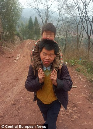 Devoted: Chinese father Yu Xukang carries his son to school every day - a round-trip of 18 miles