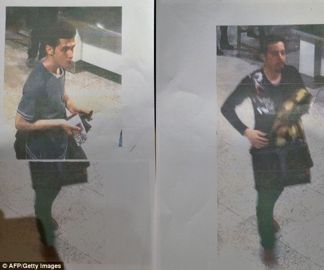 The two men who travelled on the doomed Malaysian Airlines flight from Kuala Lumpur to Beijing on stolen passports. The younger man (left) was identified as Pouiria Nur Mohammad Mehrdad, 19, said by police in Malaysia to be an Iranian asylum seeker on his way to Germany to meet his mother. The older man (right) remains unknown.