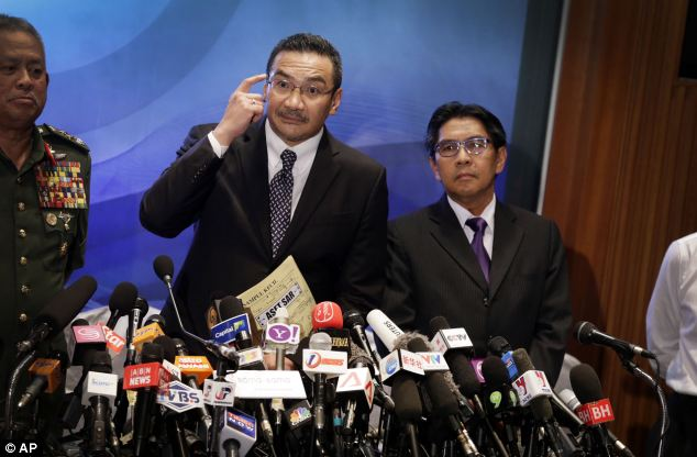 Malaysia's acting transport minister Hussein Hishammuddin (centre) has said the search for the missing Malaysia Airlines flight is now covering 27,000 square nautical miles