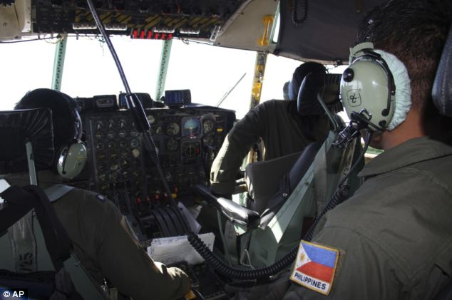 Philippine Air Force C-130 crew members continue their search and rescue mission over the South China Sea on Tuesday, more than four days after a Malaysia Airlines jetliner went missing en route to Beijing